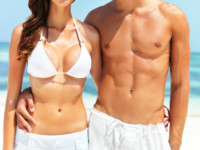 fit couple at the beach